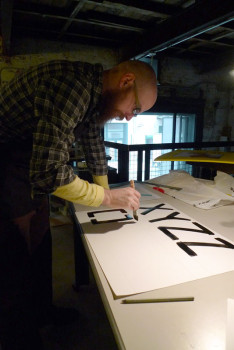 Steve Lambert drawing the font