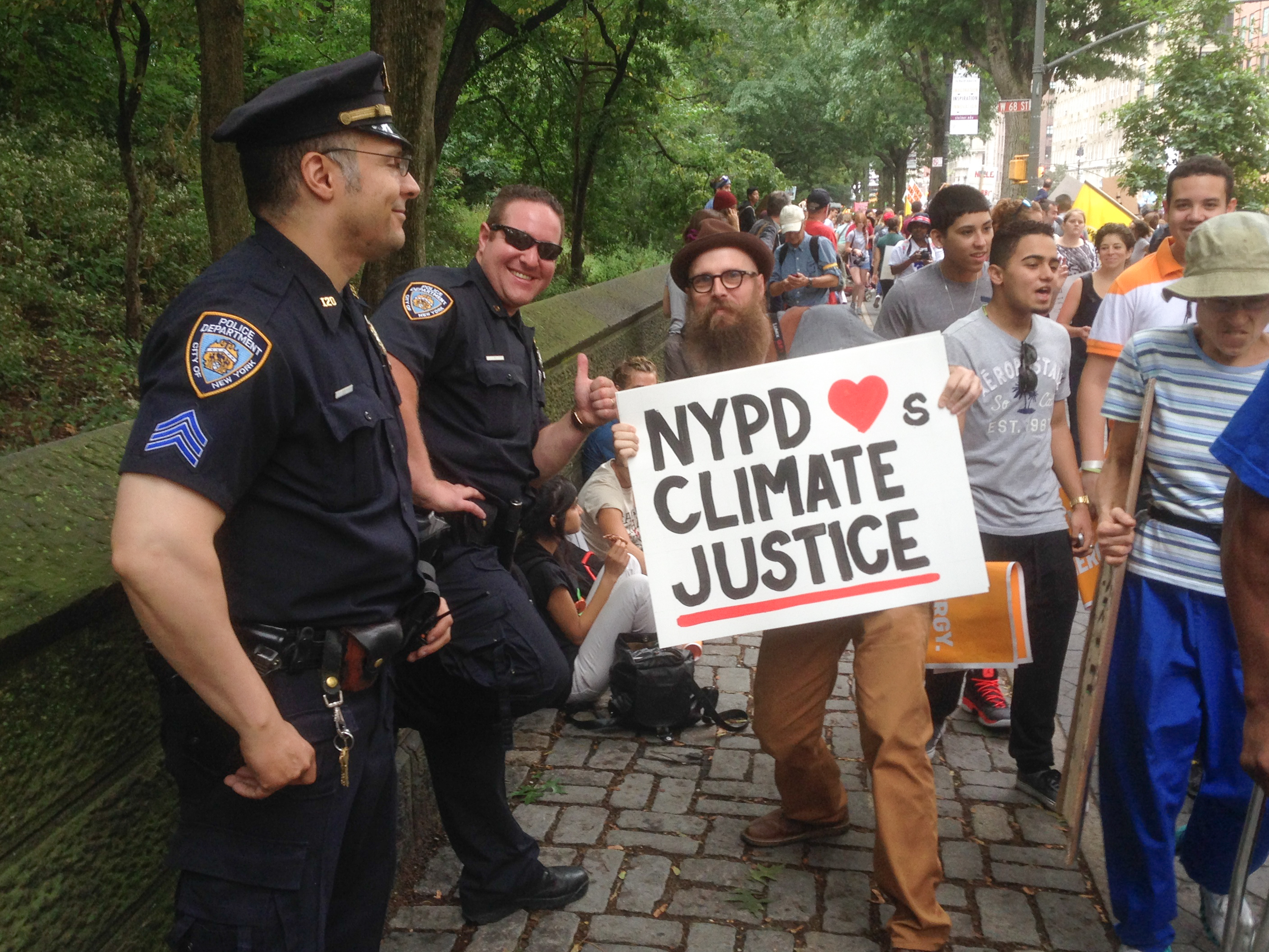 Steve Lambert Posing with Police for Climate Justice